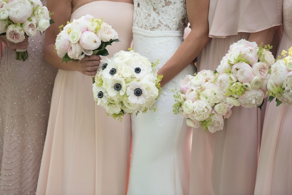 bridal bouquet with anemone blossoms, bridesmaid bouquets with peonies