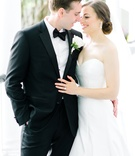 classically dressed groom tux embracing bride southern wedding Suzanne Neville love first look