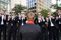 a groom with red under collar on Wisconsin university of Wisconsin alma mater groomsmen w with hands
