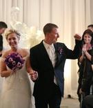 Newlyweds exit indoor ceremony