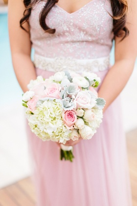 Bridesmaid in pink dress silver embellishments embroidery white hydrangea pink rose dusty miller