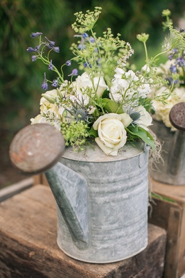 Antique flower can filled with garden florals