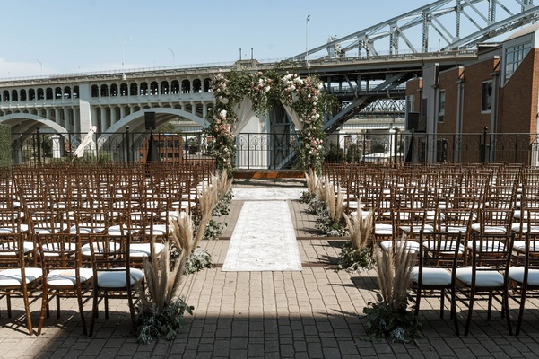bridge wedding ceremony superior viaduct cleveland wood chair vintage runner rugs pampas grass