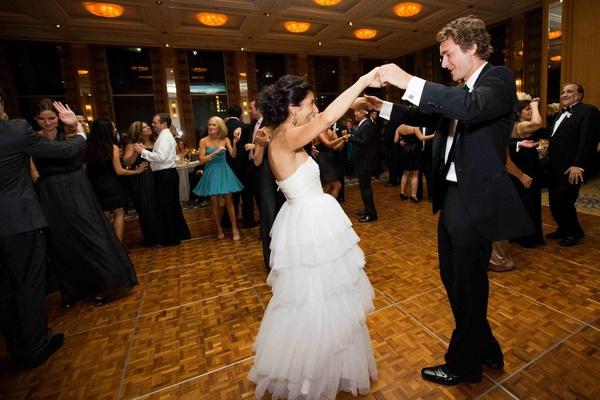 Bride in Monique Lhuillier dress and groom on dance floor