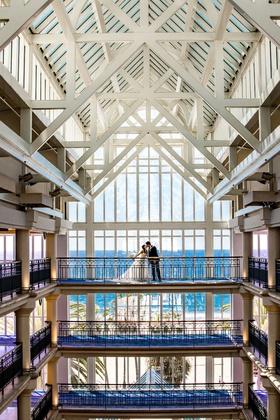 wedding portrait bride and groom on top floor of hotel atrium ocean view loews santa monica