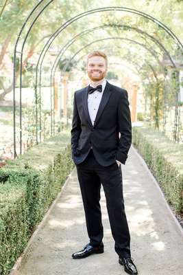 groom in hugo boss tuxedo, calamigos ranch wedding, outdoor groom portait