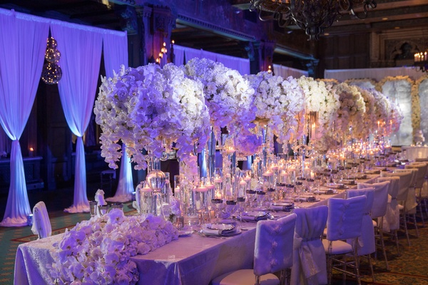 Wedding reception drapery long table with runner and tall centerpieces white orchid flowers