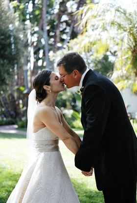 Newlyweds leaning in for a kiss