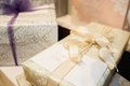 Wedding gift presents registry with bows and cards from friends and family