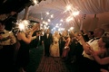 guests hold sparklers to form an arch