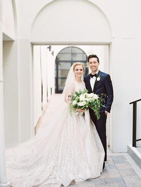 bride in high neck bateau neckline lazaro wedding dress veil groom in navy suit vibiana wedding
