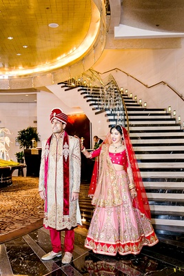 Indian-American bride and groom in traditional wedding attire during first look