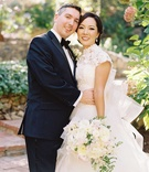 Caroline Sung in Vera Wang wedding dress with Robert Bowling in tuxedo on wedding day