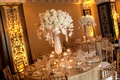 Tall white centerpieces with gold table accents