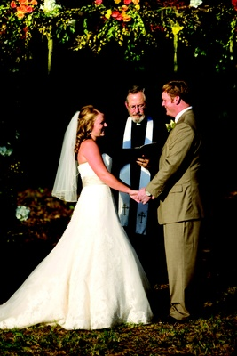 Bride in a Vera Wang Gown with groom in a tan suit at outdoor ceremony