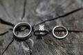silver wedding band, engagement ring and diamond wedding band