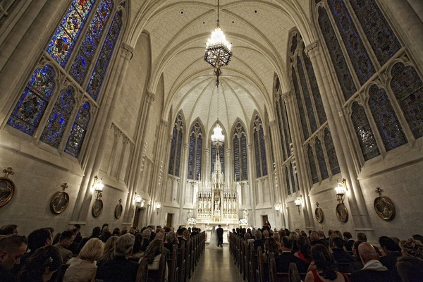 Wedding ceremony at Catholic church with vaulted ceilings