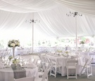 White tent with grey runners and silver vessels