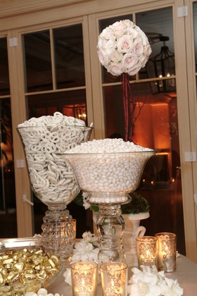 Candy bar with white colored treats for wedding guests