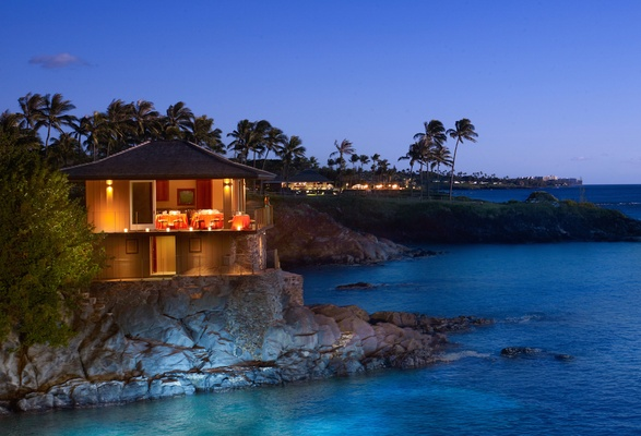 Bungalow on rock overlooking Hawaii ocean