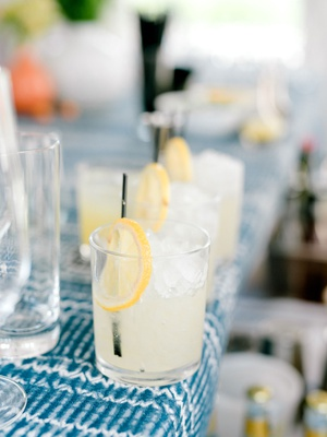 summer bridal shower cocktail idea gin green tea apricot sage yuzu and lemon garnish blue white