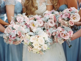 Bride bouquet white rose with greenery and bridesmaid bouquets with pink roses and the same verdure