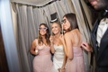 Bride and bridesmaids in silly photobooth