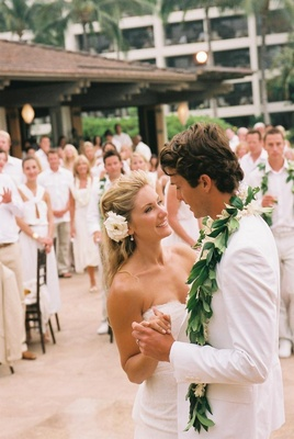 3f03139df8fe ... Guests wearing white clothes watch first dance · Hawaiian ...