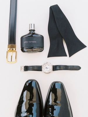 Groom's patent leather dress shoes, watch, bow tie, john varvatos cologne perfrume, and black belt