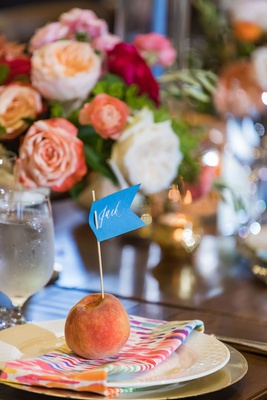 wedding reception wood table colorful napkin fresh peach fruit with flag place card