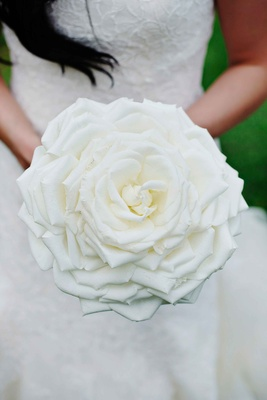 Bride holding white glamelia composite wedding bouquet
