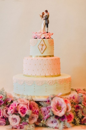 Wedding cake with key and fairy wing cake topper gold border light blue light pink vintage inspired