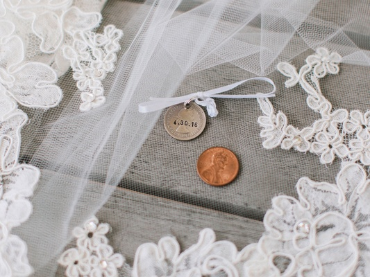 Bride's lace veil with sixpence and penny lucky tradition
