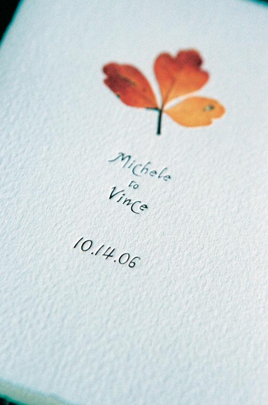 program embellished with dried red leaf