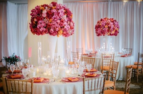 White linens and vases topped with pink and orange details