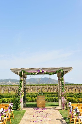 Ceremony structure in front of wine vineyard