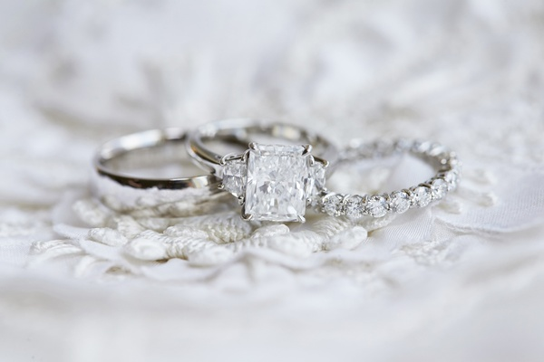 radiant-cut diamond engagement ring with triangle sidestones