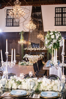 ebell long beach wedding with candles, white flowers, and greenery. chandeliers with sphere around