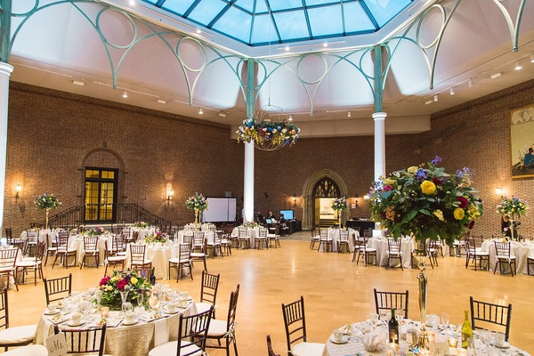 open reception space round tables floral accents dayton ohio art institute wedding venue unique