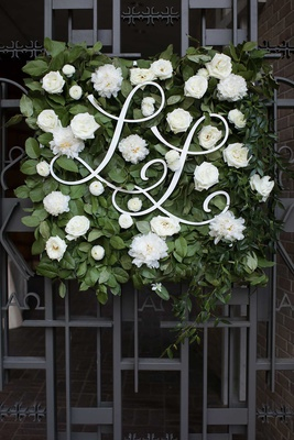 wedding ceremony iron doors green square white flowers monogram cursive laine and layne