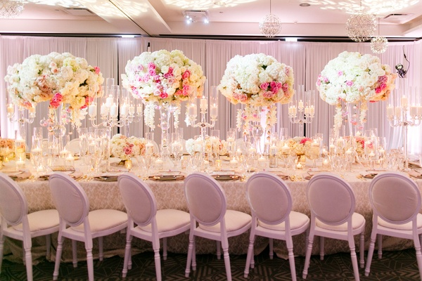 blush and ivory flower arrangements with glass candelabra with candles