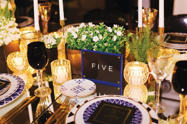 destination wedding table number blue border black and white block letters mykonos destination