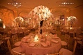Round tables topped with tall floral arrangements