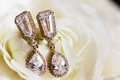Wedding day jewelry drop earrings teardrop shape diamond halo and stud details