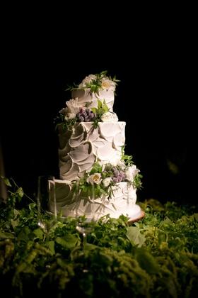Alexis Cozombolidis and Hunter Pence wedding cake white frosting fresh flowers greenery three layer