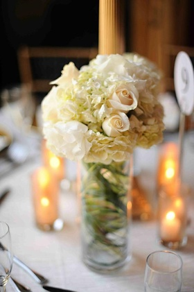 Glass cylinder filled with roses and hydrangeas