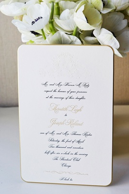 Classic invitation with embossed monogram calligraphy gold border rounded corners black tie attire