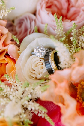 bridal bouquet white pink orange flowers round solitaire engagement ring men's band black gold