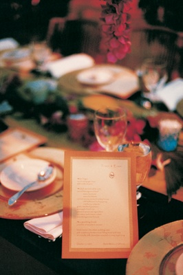 orange and white menu on reception table