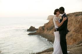 bride groom kiss cliffside southern california wedding chic dress ocean rocks venue